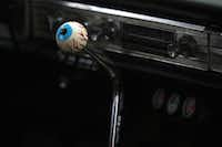 An eyeball knob tops off a Hurst shifter in a late '60s Impala in Aubrey on Saturday.David Minton - DRC