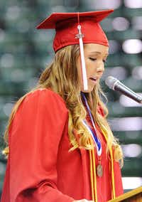 Bailey Slaughenhaupt delivers the invocation during commencement exercises for Aubrey High School on Friday at the UNT Coliseum.Ray Watson - For the DRC