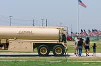 A family on a tour of the new Denton U.S. Army Reserve Center for the 957th Quartermaster Company checks out a fuel tanker vehicle parked outside, Saturday, July 13, 2013, in Denton, TX.David Minton - DRC