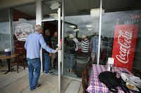 The order line snakes out the door only 40 minutes after opening Thursday at Bet the House BBQ on South Elm Street.David Minton