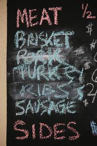 A chalkboard menu lists options at Bet the House BBQ.David Minton