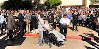 Brian Bravo was greeted in front of The Colony High School by students, faculty and city officials during a special ceremony Friday <137>april 25 <137>in which the Bravo family was presented with a wheelchair-accessible van and a check for $25,000 for Bryan's care.Photos by Barron Ludlum