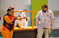 "Harold the dog (Shane Strawbridge, right) and Chester the cat (Ariana Cook) have a mystery on their hands in ""Bunnicula,"" a musical for all ages presented by Texas Woman's University. Angele Phillips is the puppeteer Bunnicula.David Minton - DRC"
