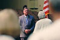 U.S. Rep. Michael Burgess, R-Lewisville, listens to a question as he conducts a town hall meeting with constituents at Denton Bible Church on Thursday.David Minton - DRC