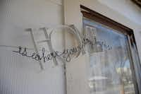 "A decorative piece that reads ""Home is where your story begins"" greets guests outside the Cadena home. The Cadenas came to Denton in 2000 to visit family and decided to stay.Caitlyn Jones"