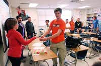 Brian Zellmer walks around the group as Denton High School students from the Peer Assistance Leadership and Service program work on an exercise recently for the upcoming Campecine Film Festival, set for Saturday at the University of North Texas.David Minton