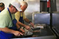 Milton Fette and David Martinez work the griddle at Captain Nemo's on Wednesday.Photos by David Minton