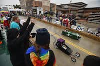 Fans in the grandstands cheer for the coffin races at Denton's Day of the Dead Festival last year.David Minton