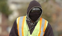 Nicholas Irvin, a utilities locator for U.S. Infrastructure Corp., is bundled up against the cold on Lone Star Lane on Wednesday in Denton.Al Key