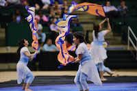 The Guyer High School color guard performs at the Winter Guard International Southwestern Color Guard Championship on Saturday at the University of North Texas Coliseum in Denton.David Minton - DRC