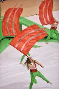 The Justin Northwest High School color guard performs at the Winter Guard International Southwestern Color Guard Championship on Saturday at the University of North Texas Coliseum in Denton.David Minton - DRC