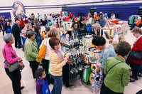 People browse the wares at vendor booths Saturday in the Denton High School gymnasium.David Minton - DRC