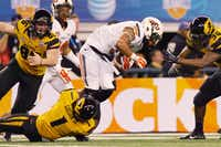 Oklahoma State junior wide receiver Josh Stewart, right, is tackled by Missouri's Josh Gibson on a kick return during the Cotton Bowl on Friday in Arlington.David Minton