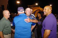 Former Denton High School football coach Bill Peteet (center) is greeted by Eddie Lane (cap) and other former players during halftime of the Broncos homecoming game against Wichita Falls Friday October 11, 2013, in Denton, Tx.Al Key - DRC