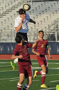 Denton's Michael Husbands (3) heads the ball during their playoff game against Saginaw in Flower Mound Tuesday March 25, 2014.Ray Watson - For the DRC