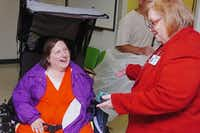 Denton State Supported Living Center Director Nancy Condon, right, visits with resident Mary Blakely on Thursday. The center is home to 461 residents.Al Key - DRC