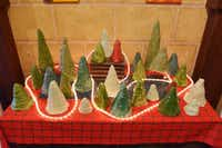 A table out front displays ceramic Christmas trees created by residents of the Denton State Supported Living Center at Impressions by DSSLC. Center residents come to the shop on the Square to make ceramic and other creative items for sale.David Minton
