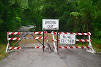 Duck Creek Road a mile west of Sanger, which is 12 miles north of Denton, is closed Wednesday after flooding damaged the bridge recently.Al Key