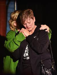 Cathy McMullen, president of the Denton Drilling Awareness Group, hugs Sharon Wilson, an organizer with the group Earthworks, onstage at an election watch party Tuesday night at Dan's Silverleaf.David Minton