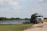 A tank truck operator works in May at a groundwater lake used to supply water for hydraulic fracturing outside Bowie in Montague County.Christian McPhate - For the DRC