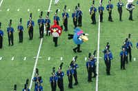 "A pair of ""Angry Birds"" characters dance on the field as part of the show by the Trophy Club Nelson High School marching band at the Golden Triangle Classic on Saturday in Denton.David Minton - DRC"