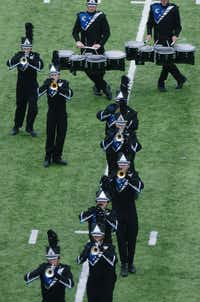 The Guyer High School Wildcat Band performs Saturday during the Golden Triangle Classic, hosted by Denton High School, at C.H. Collins Athletic Complex.David Minton - DRC