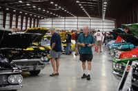 Fans admire classic cars at the sixth annual Faith Presbyterian Hospice Car Show, presented by the Lake Cities Misfits Car Club at Robinson Restoration and Service in Denton.David Minton - DRC