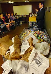 Mayor Mark Burroughs announces the results of a weeklong competition to collect food leading up to the third annual Mayor's Day of Concern for the Hungry in Denton during a press conference at Vision Ministries on Tuesday.Al Key