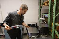 Dustin Blocker goes through stacks of vinyl records at Hand Drawn Pressing.Jeff Woo