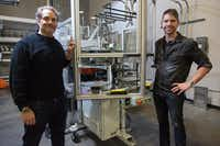 Hand Drawn chief operations officer Alex Cushing, left, and chief creative officer Dustin Blocker stand by the new WarmTone  press from Viryl Technologies, which can turn out a 12-inch vinyl record — from melted PVC pellets to finished album — in 33 seconds.Photos by Jeff Woo