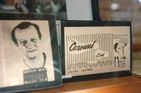 """An image of a business card for the Carousel Club, owned by Jack Ruby, sits next to a mugshot of Ruby in the """"JFK Texas Exhibit""""at the Western Heritage Gallery.David Minton - DRC"""