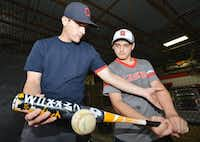 Jared McClure, left, helps 13-year-old Joshua Hunter with the mechanics of his swing recently in Denton.Al Key