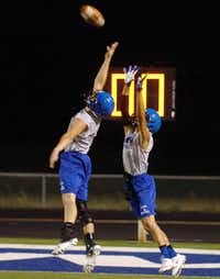 Krum players go after a pass during drills during their first practice just after midnight at Bobcat Stadium Monday August 5, 2013, in Krum, Tx.Al Key - DRC