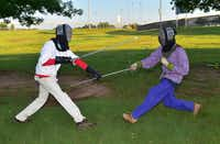 Corwyn Hamilton, left, battles with Joshua Everett on Monday at North Lakes Park. Members of the Canton of Glaswyn, part of the Society for Creative Anachronism, meet weekly at the park.Al Key