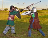James Moore, left, and Jesse Jones engage in live-action role playing Monday at North Lakes Park. Members of the Society for Creative Anachronism work to recreate the arts and skills of pre-17th century Europe.Al Key