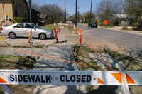 Sidewalks lining North Locust Street were undergoing reconstruction last week. New curb ramps are designed to improve accessibility for people with mobility and vision impairments.David Minton - DRC