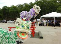 Thursday's groundbreaking for the Long Lake development in Corinth included a lion dance, as is traditionally done during groundbreaking ceremonies in China.Al Key