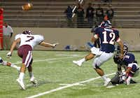 Ryan senior Marc Orozco kicks a field goal against Lewisville on Oct. 25 at C.H. Collins Athletic Complex.Al Key - DRC