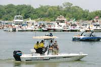 "Denton County Sheriff's deputies patrol boats in ""Party Cove"" on Lewisville Lake near West Lake Park, Saturday, July 6, 2013, in Hickory Creek, TX.David Minton - DRC"