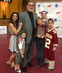 Texas-Pan American women's basketball coach Larry Tidwell is surrounded by his grandchildren recently in Sherman when Austin College gave him the Coach Joe Spencer Award for Meritorious Service and Lifetime Achievement in Coaching.Courtesy photo