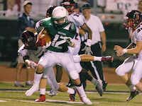 Lake Dallas sophomore wide receiver Keegan Brewer (12) fights through a tackle attempt by Frisco Centennial senior safety Matt Carrillo (7), Friday, September 6, 2013, at Falcon Stadium in Corinth, TX.David Minton