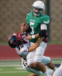 Lake Dallas sophomore quarterback Dagan Haehn (5) is brought down by Frisco Centennial junior linebacker Slevin Montague (42), Friday, September 6, 2013, at Falcon Stadium in Corinth, TX.David Minton