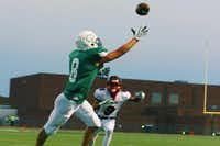 Lake Dallas senior wide receiver Brandon Simpson (8) reaches out but can't get to a catch in the endzone against Frisco Centennial, Friday, September 6, 2013, at Falcon Stadium in Corinth, TX.David Minton