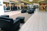Large leather chairs offer inviting spaces for shoppers to relax during visits at Golden Triangle Mall.David Minton - DRC