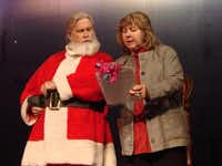"<TypographyTag11>LEFT:</TypographyTag11> Kris Kringle (Randal McCasland), hired to play Santa, objects to Ms. Shellhammer's (Sara Martin) directions to sell toys that her store has overstocked. ""Why not give the children what they want?"" he asks.Nelda Evarts"