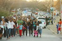 The march passes Fred Moore Park on Wilson Street on the way to the Martin Luther King Jr. Recreation Center on Monday in Denton.Al Key