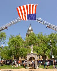 The Denton Fire Department flew an American flag between two ladder trucks Thursday during the National Day of Prayer service at the Courthouse on the Square.Al Key