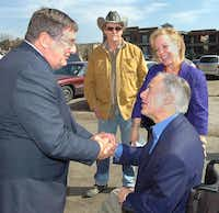 U.S. Rep. Michael Burgess, left, greets gubernatorial candidate Greg Abbott, Ted Nugent and state Rep. Myra Crownover as they arrive at El Guapo's for Abbott's campaign speech Tuesday in Denton.Al Key