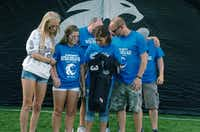 The family of Guyer High School senior Nathan Maki receives his #33 jersey during a pre-game ceremony before kickoff against Colleyville-Heritage, Thursday, September 5, 2013, at C.H. Collins Athletic Complex in Denton, TX.David Minton - DRC