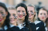 Guyer senior Maria Cachon and other members of the Guyer drill team wear a #33 on their cheek in honor of senior Nathan Maki who was killed over Labor Day weekend, during pre-game ceremonies before the game against Colleyville-Heritage, Thursday, September 5, 2013, at C.H. Collins Athletic Complex in Denton, TX.David Minton - DRC